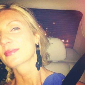 Alison, Scottish beauty wearing De' Mel S shape black Venetian lace earrings with black swarovski crystal and silver hardware