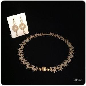Royal gold Venetian lace necklace and matching earrings with gold hardware and drop shape synthetic pearls