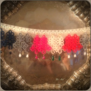 Italian ornamental cord collection in various colors (left to right) royal night blue,pearl gray, bright pink, sand white,passion red and light gray with various semi- precious stones
