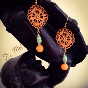Spring summer details...De' Mel in tangerine lace with turquoise and orange beads.
