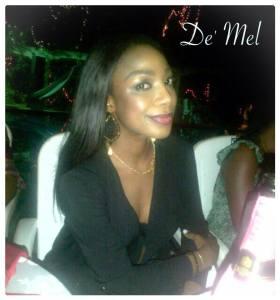 Nigerian beauty wearing De' Mel Venetian lace earrings in black with gold detail and gold hardware