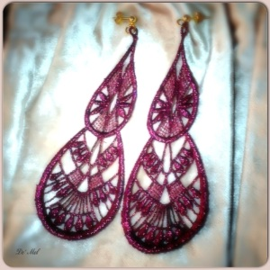 Large tear drop sparkly granate color Venetian lace earrings with gold hardware