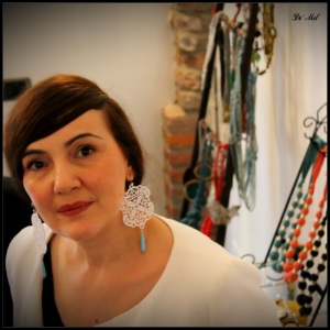 Serbian beauty wearing De' Mel large hexagon Venetian lace earrings in Pure white with tear drop turquoise and 925 sterling silver hook and hardware
